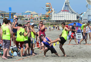 Wildwoods Beach Frisbee: Team from Colgate University (wearing yellow) plays a team from the NY State area. Saturday July 27 2013 Wildwoods Beach Frisbee Tournament on the beach at Poplar Avenue. (The Press of Atlantic City / Ben Fogletto) - Ben Fogletto