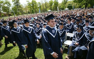 ST. AUGUSTINE GRADUATION: Graduates move to receive diplomas. The event was held outside on campus. Sunday May 18 2014 St. Augustine Prep Graduation. (The Press of Atlantic City / Ben Fogletto) - Ben Fogletto