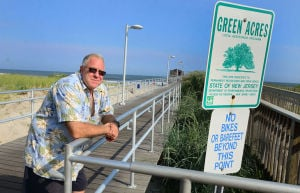 Open Space: Ventnor Mayor Mike Bagnell stands on the pier next to a sign designating the pier as a Green Acres site. Monday July 29 2013 Ventnor Pier related to open space measure that was up for a vote in the senate on Monday. (The Press of Atlantic City / Ben Fogletto) - Ben Fogletto