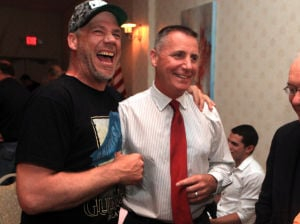 Atlantic County Republican Primary: Terry Kenney, of Brigantine, left, congratulates Franks Balles on winning the Republican primary contest for state senate at the Sandi Pointe Restaurant, in Somers Point, Tuesday June 4, 2013.  - Photo by Vernon Ogrodnek