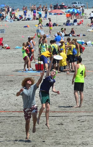 Wildwoods Beach Frisbee: Richard Kingston of Raliegh NC (left) and Oliver Burkowitz of Washington DC jump for a frisbee during warm-ups. Saturday July 27 2013 Wildwoods Beach Frisbee Tournament on the beach at Poplar Avenue. (The Press of Atlantic City / Ben Fogletto) - Ben Fogletto