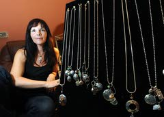 She's facing life's troubles with jewelry and ideas