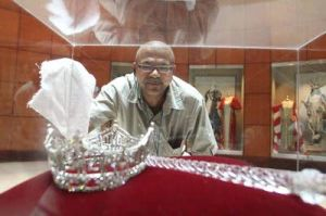 Miss A Returns: Rudy Jimenez, of Atlantic City, cleans the glass casing of the Miss America crown and scepter at the Sheraton Atlantic City. - Edward Lea