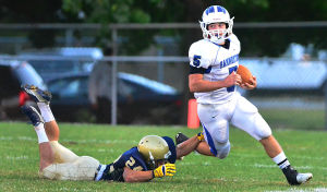Holy Spirit Football: Hammonton's 5 Dylan Rosu escapes Holy Spirit's 24 Franco Rifici during the 1st quarter. Friday September 13 2013 Hammonton at Holy Spirit high school football. (The Press of Atlantic City / Ben Fogletto) - Photo by Ben Fogletto