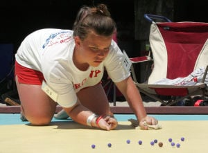 : Girls runner-up Briana Brode 13, of Allegany, Md. shoots during the finals of the 90th annual National Marbles Tournament held on the beach at Ringer Stadium in Wildwood. Thursday June 20, 2013. (Dale Gerhard/The Press of Atlantic City)  - Dale Gerhard