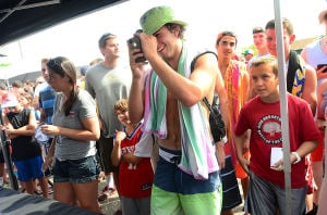 76ers Beach Bash: Holden Young, 15, of Pennington, NJ takes a picture of 76ers' Nerlens Noel at the 76ers' Annual Beach Bash at Jack's Place in Avalon, Saturday July 27 2013. (The Press of Atlantic City / Ben Fogletto) - Ben Fogletto