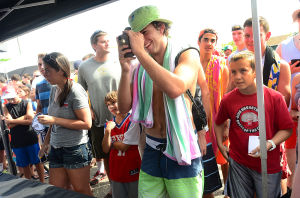 76ers Beach Bash: Holden Young, 15, of Pennington, NJ takes a picture of 76ers' Nerlens Noel at the 76ers' Annual Beach Bash at Jack's Place in Avalon, Saturday July 27 2013. (The Press of Atlantic City / Ben Fogletto) - Photo by Ben Fogletto