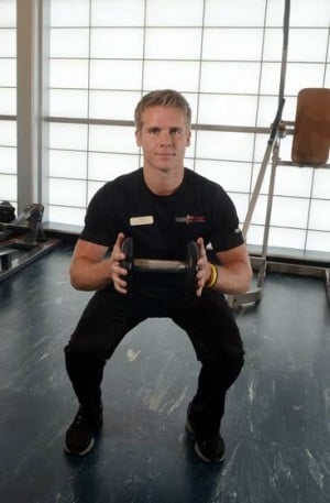 Your Workout: Squat with knee lift and torso rotation