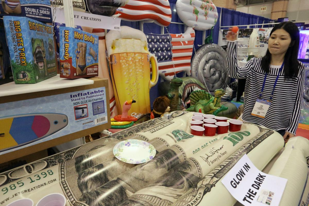 Fun games and plenty of serious business at a c pool for Pool and spa expo