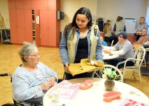 Galloway-based Girl Scouts serve tea, cookies at Absecon Manor