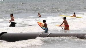 Beach: Beachgoers enjoy the water at New Jersey Ave beach in Atlantic City Saturday. A University of Delaware study looking into beach injuries has made a correlation between dangerous shore breaks and spinal/neck injuries. - Photo by Edward Lea
