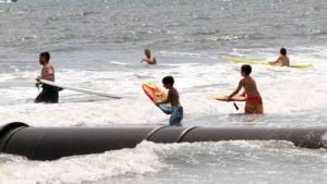Beach: Beachgoers enjoy the water at New Jersey Ave beach in Atlantic City Saturday. A University of Delaware study looking into beach injuries has made a correlation between dangerous shore breaks and spinal/neck injuries. - Edward Lea