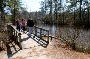 Birch Grove Park: Alexandria Manno, 19 of Somers Point, Morgan Owens, 19 of Somers Point, and Dennis Gibson, 21 of Egg Harbor City, stroll across one of the scenic bridges on the nature trails at Birch Grove Park, in Northfield. Tuesday, March, 19, 2013( Press of Atlantic City/ Danny Drake)  - Danny Drake
