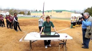 OLMA Softball: Melissa Connor, head coach of Our Lady of Marcy Academy softball team percent a jersey ball and bat to Geri Patrick of Georgia mother of former softball coach Jamie Cook who died suddenly over the winter at a young age Tuesday, April 8, 2014. - Edward Lea