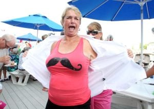 NIGHT IN VENICE: Barbara Gill of OCean Citytake part in mustache theme party during Night in Venice boat parade in Ocean City Saturday, July 20, 2013. - Photo by Edward Lea