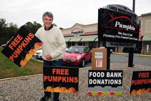 EHT car dealer to give away pumpkins, collect canned goods, money for FoodBank