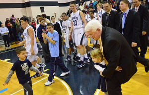 Paul Rodio: Grandchildren Phil, 6, left, and Mia, 4, Brunozzi rush onto the court to celebrate with St. Augustine Prep basketball coach Paul Rodio after he earned the South Jersey-record 776th win of his career Monday in Buena Vista Township. 'It's not really about me,' Rodio said of the milestone.  - Staff photo by Ben Fogletto