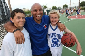 Dbml Y10 Basketball: Coach Frank Gilliam, of Atlantic City, center, posed with players Colin Keane, 13, of Margate, left, and Andrew Redmond, 12, of Ocean City, at the South Jersey Starz Youth Basketball Organization basketball tournament June 28 in Margate. - Sean M. Fitzgerald