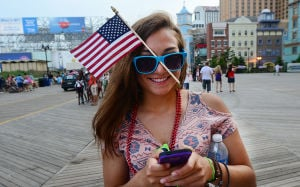 AC Salutes Armed Forces Parade: Hannah D'Amico of Ventnor wears a flag in her sunglasses. Monday June 24 2013 Atlantic City Salutes America's Armed Forces Parade Atlantic City Boardwalk. (The Press of Atlantic City / Ben Fogletto)  - Ben Fogletto
