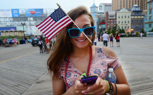 AC Salutes Armed Forces Parade: Hannah D'Amico of Ventnor wears a flag in her sunglasses. Monday June 24 2013 Atlantic City Salutes America's Armed Forces Parade Atlantic City Boardwalk. (The Press of Atlantic City / Ben Fogletto)  - Photo by Ben Fogletto