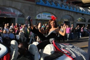 MISS AMERICA PARADE: Miss Alabama Chandler Champion show off her shoe as she waves to during Miss America parade on Atlantic City Boardwalk Saturday, Sept 14, 2013. - Photo by Edward Lea