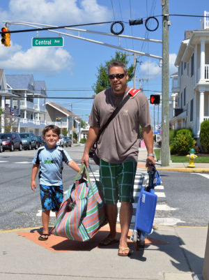CASEY'S LAW: Josh Ervine, and son Reid, 6, of Somerdale, NJ, walk through the intersection at 14th and Central Avenue in Ocean City, Monday July 15, 2013, where Casey Feldman was killed in 2011. New traffic signals have been added. (The Press of Atlantic City/Staff Photo by Michael Ein) - Michael Ein