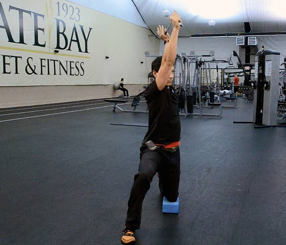 Your Workout: Half-kneeling long turns with club