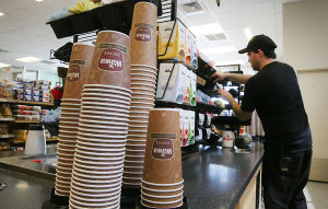 WaWa: Employee Stephen Shrom of EHT works to replenish the coffee station. Sunday April 13 2014 Customers buy coffee at the new WaWa on Rt 52 in Somers Point. WaWa will celebrate it's 50 year anniversary this week. (The Press of Atlantic City / Ben Fogletto) - Ben Fogletto