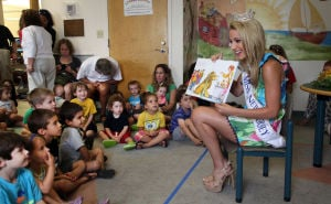 Miss NJ In Margate: Cara McCollum, Miss New Jersey, originally from Forrest City, Arkansas , reads to children at the Margate Library, in Margate, Wednesday July 10, 2013. - Photo by Vernon Ogrodnek