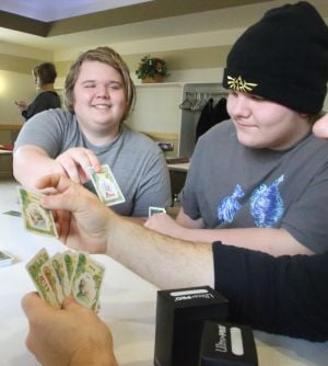 A THEATER FOR THEM: Tomothy Elmer, 17, left of Egg Harbor Township and Christopher LeCain, 14 right of Barnegat play card game Once Upon a Time at Northfield Public Library Saturday, Feb 16, 2014. Jester's Playhouse, a local magic/trading card shop, hosts a weekly club for children with developmental disorders - Edward Lea