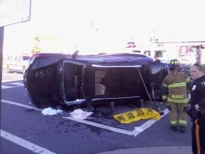 Margate Crash: A vehicle rests on its side after a crash Thursday in Margate.  - Photo by Steven Lemongello