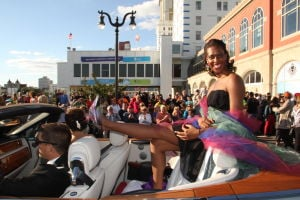 MISS AMERICA PARADE: Miss Alaska Michelle Taylor show off her shoe as she waves to during Miss America parade on Atlantic City Boardwalk Saturday. - Edward Lea