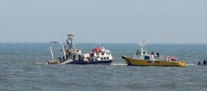 Boat Raised: The Cape Hatteras is lifted from the ocean off Ocean City.  - Ben Fogletto