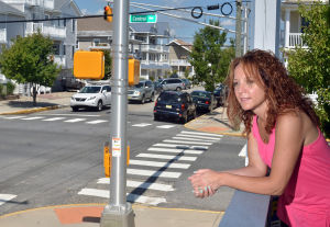 CASEY'S LAW: Ocean City summer home owner Jennifer Gentile, of Maple Glen, PA, looks over the intersection, Monday July 15, 2013, where Casey Feldman was killed in 2011. New traffic signals have been added. (The Press of Atlantic City/Staff Photo by Michael Ein) - Michael Ein
