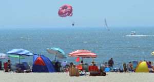 JL08 Holiday Weekend: People crowd the beach near 10th Street in Ocean City. Sunday July 7 2013 4th of July Weekend in Ocean City. (The Press of Atlantic City / Ben Fogletto) - Ben Fogletto