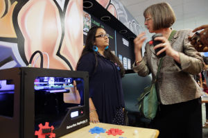 MAKER SPACE: Asha Chowdhoury, 17, of Atlantic City, left, speaks with NJ State Librarian Mary L. Chute, Monday April 14, 2014, at The Atlantic City Free Public Library's new Teen Maker Space in Atlantic City. (Staff Photo by Michael Ein/The Press of Atlantic City) - Michael Ein