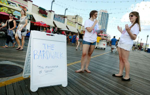 Bardwalk: Lauren Kropa of Jackson and Emily Tootell of Burlington County perform a scene on the Boardwalk at MLK. Sunday August 4 2013 Stockton students and alumni perform Shakespeare on the Atlantic City Boardwalk. (The Press of Atlantic City / Ben Fogletto) - Ben Fogletto
