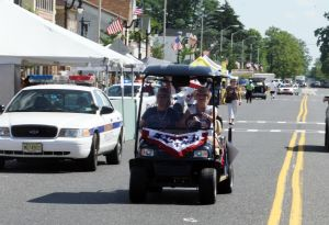 5K Race: People attend The Greater Egg Harbor City Chamber of Commerce ever Hometown Saturday, July 6, 2013. The events kicks off the city's annual Hometown Celebration, which is held on the 100 block of Philadelphia Avenue in Egg Harbor City. - Edward Lea