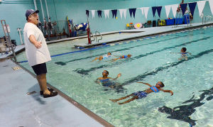 SWIM CLASSES: Instructor Dave Demarest of Galloway conducts the lessons poolside. Monday July 15 2013 Swimming lessons at the pool of the Martin Luther King School Complex in Atlantic City. (The Press of Atlantic City / Ben Fogletto) - Ben Fogletto