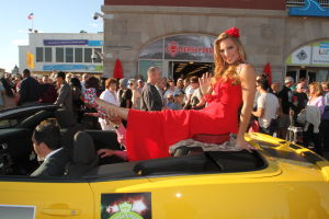 MISS AMERICA PARADE: Miss Colorado Meg Kardos show off her shoe as she waves to during Miss America parade on Atlantic City Boardwalk Saturday, Sept 14, 2013. - Edward Lea