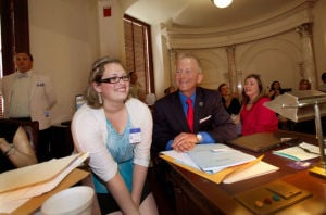 DYSLEXIA BILLS-  201204779: Samantha Ravelli sits with state Sen. Jeff Van Drew, D-Cape May, Cumberland, Atlantic, during votes Thursday to adopt legislation requiring better assistance for students with dyslexia. - Press photo by Brian Branch Price