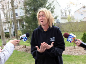 Boater Missing: Lynsey McAuliffe, talks about her husband, David McAuliffe, 35, of Egg Harbor Township, lead captain of a 45-foot Sea Tow boat who is missing at sea, Wednesday April 25, 2013., outside her home.  - Photo by Vernon Ogrodnek