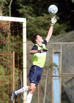 MIddle Spirit Boys Soccer: Spirit goal keep Bobby Hudak, reaches for a save. Middle Township vs. Holy Spirit in a CAL boys soccer match up in Cape May Court House. Middle won 8-0. Friday Sept. 20, 2013,. (Dale Gerhard Photo/Press of Atlantic City) - Photo by Dale Gerhard