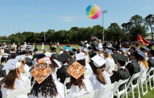 MIddle Township Graduation: Middle Township graduates toss around a beach ball during the ceremony. Middle Township High School held their 106th annual commencement ceremony on Memorial Field in Cape May Court House. Tuesday June 24, 2014. (Dale Gerhard/Press of Atlantic City) - Dale Gerhard