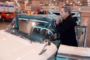 Ac Car Show: Show manager, John Chiara, of Cherry Hill, raises the roof of his 1959 Ford Retractible. Cars begin to arrive at the Atlantic City Convention Center for the AC Car Show. Wednesday, February, 27, 2013( Press of Atlantic City/ Danny Drake)  - Danny Drake