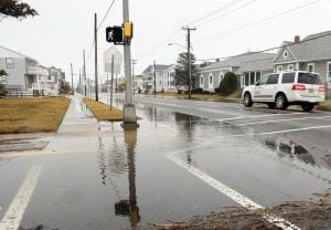 Snow Storm: Minor flooding on Third Avenue and 94th Street in Stone Harbor. Photos from Cape May County of the strong winds and minor flooding from the coastal storm. Thursday Feb. 13, 2014. (Dale Gerhard/Press of Atlantic City) - Dale Gerhard