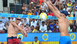 AVP VOLLEYBALL FINALS: Casey Patterson (left) gets a shot past the block of Phil Dalhausser during the men's final. Sunday September 8 2013 AVP beach volleyball tournament in Atlantic City. (The Press of Atlantic City / Ben Fogletto) - Ben Fogletto
