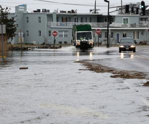 Storm-weary coastal residents weather another high tide, fear more