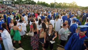Hammonton Graduation: Family and friends gather on the field to congratulate the graduates during Hammonton High School's Graduation ceremony held at the Robert Capoferri Athletic Complex in Hammonton Wednesday, June 12, 2013. Photo/Dave Griffin  - John David Griffin