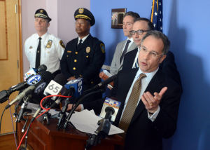 Ac Drug Gangs: With Atlantic County Sheriff, Frank Balles and Atlantic City Police Chief, Ernest Jubilee and Atlantic City Public Safety Director, Willie Glass in background, U.S. Attorney Paul J. Fishman, District of New Jersey, speaks during the press conference. U.S. Attorney Paul J. Fishman, District of New Jersey, held a press conference at the United States Attorney's Office, in Camden, Tuesday, March 26, 2013, to announce a major takedown of an alleged violent drug trafficking organization operating in Atlantic City. More than 30 members and associates of the criminal street gang Dirty Blok are charged by Complaint with conspiracy to distribute heroin. Tuesday, March, 26, 2013( Press of Atlantic City/ Danny Drake)  - Danny Drake